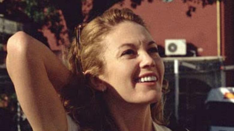 Diane Lane white dress arm behind head