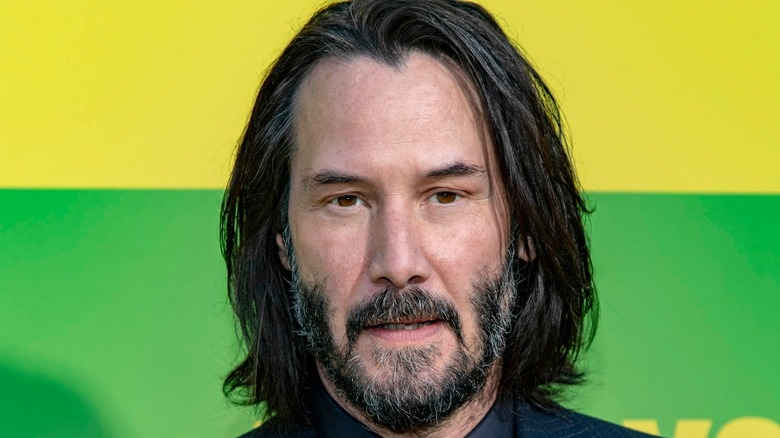 Keanu Reeves with yellow and green background
