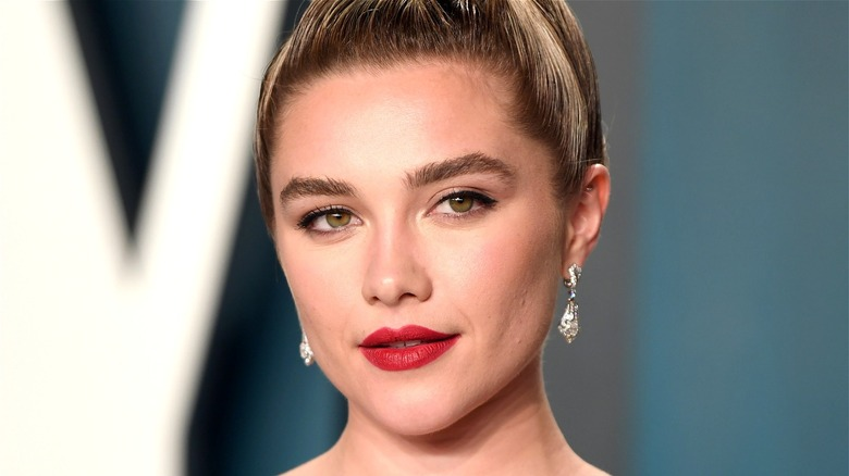 Florence Pugh posing at event