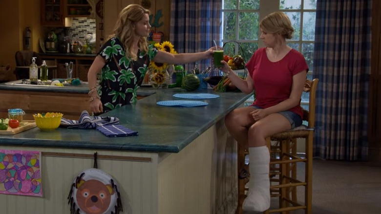 Jodie Sweetin as Stephanie Tanner and Candace Cameron Bure as D.J. Tanner-Fuller in Fuller House