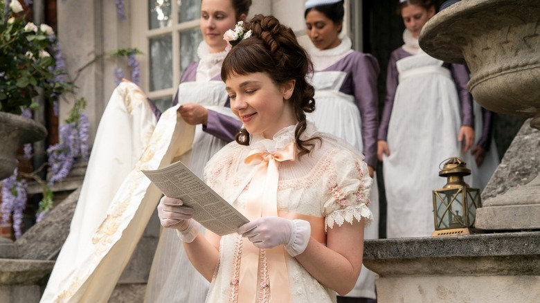 Eloise reading Lady Whistledown's column