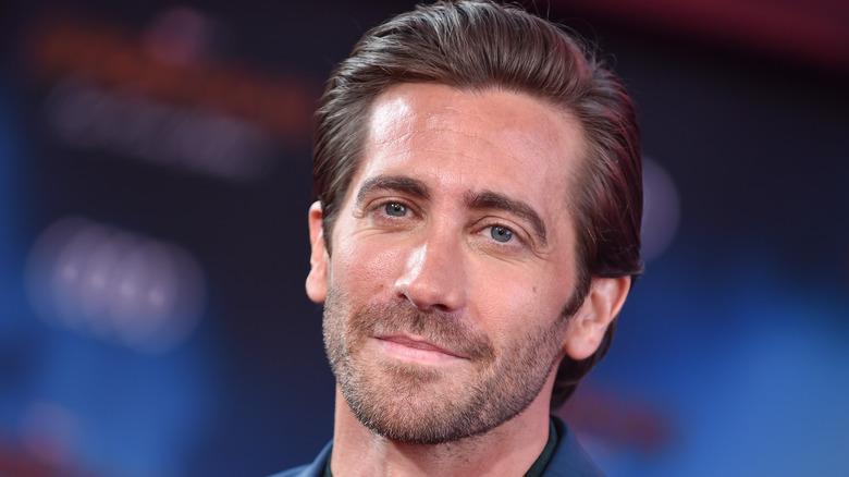 Jake Gyllenhaal posing with blue background
