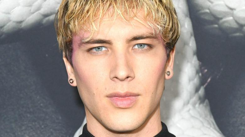 Cody Fern with blonde hair posing