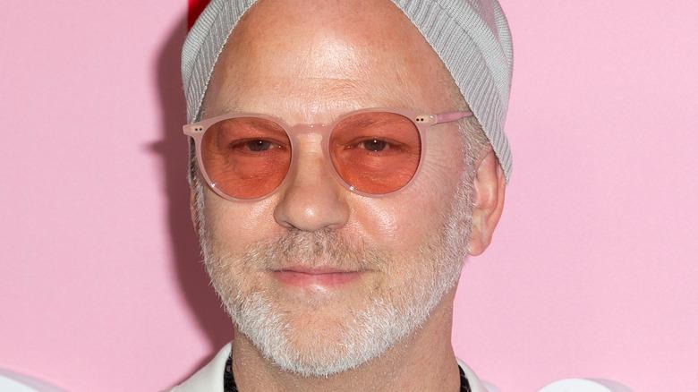 Ryan Murphy pink glasses light beard