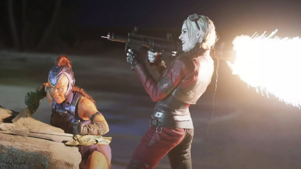 Harley Quinn with a flaming gun in The Suicide Squad