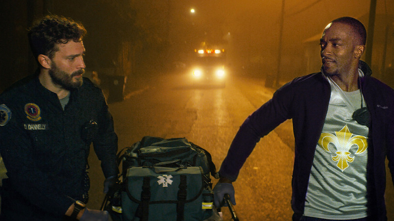 Anthony Mackie and Jamie Dornan as Dennis and Steve carrying EMT supplies in Synchronic