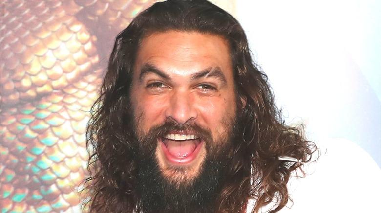 Jason Momoa mouth open smiling