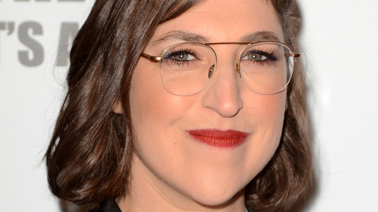 Mayim Bialik wears glasses and smiles