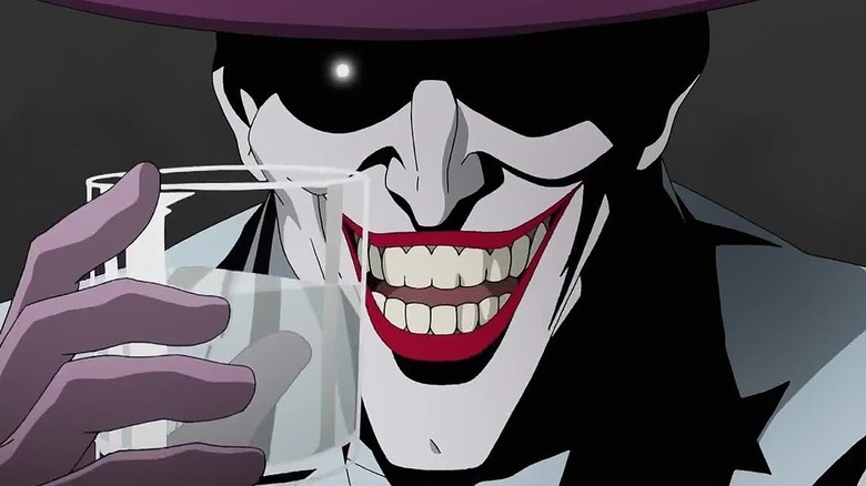 Joker grinning with glass