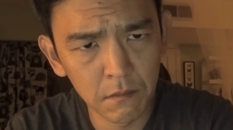 John Cho looks concerned