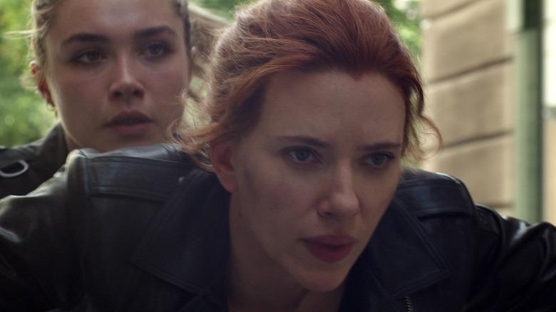 Yelena and Natasha riding motorcycle