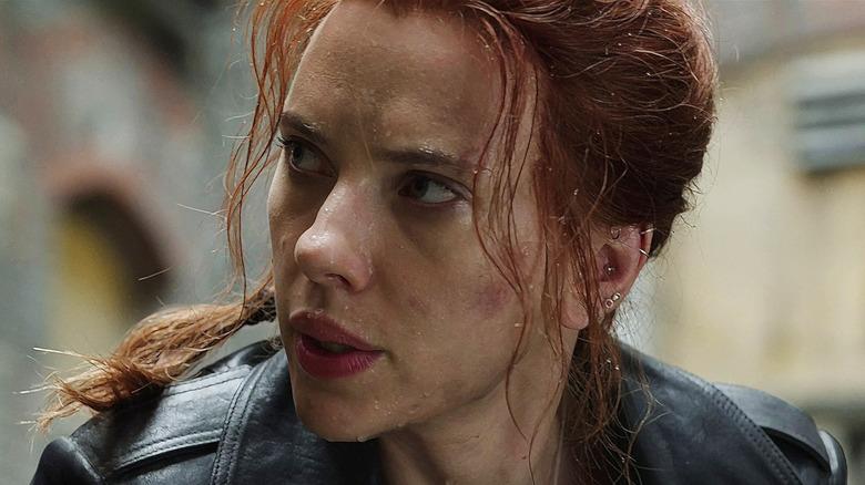Black Widow raindrops on face