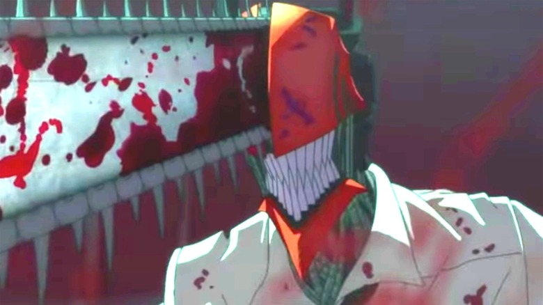 A man has a bloody chainsaw as a face