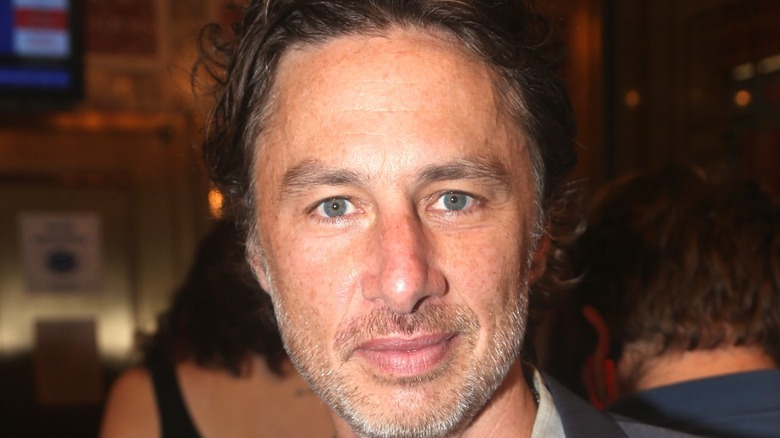 Zach Braff poses at event