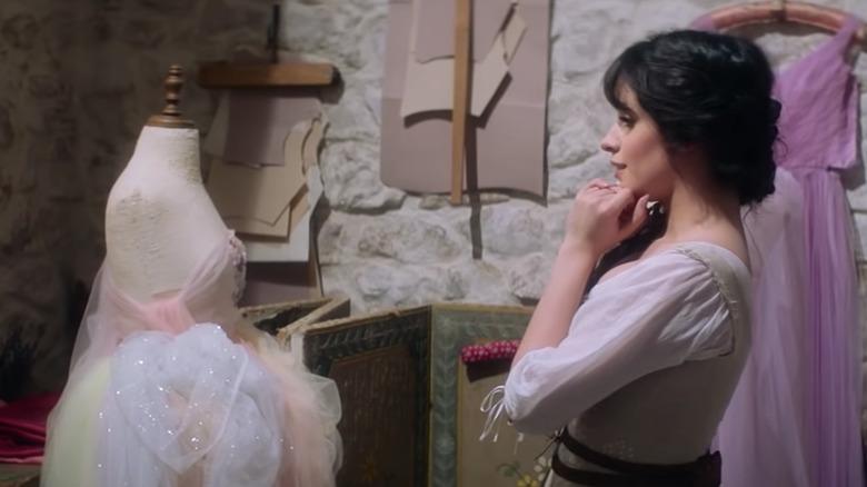 Ella looking at a dress 2021 Cinderella movie