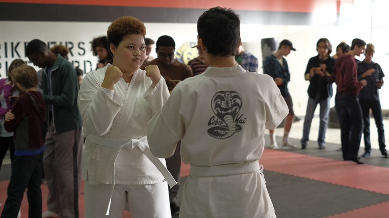 Aisha fighting with Miguel in Cobra Kai dojo