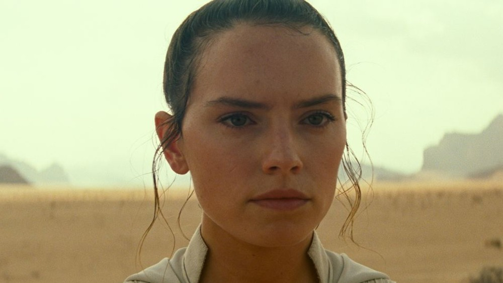 Rey stares off in the distance