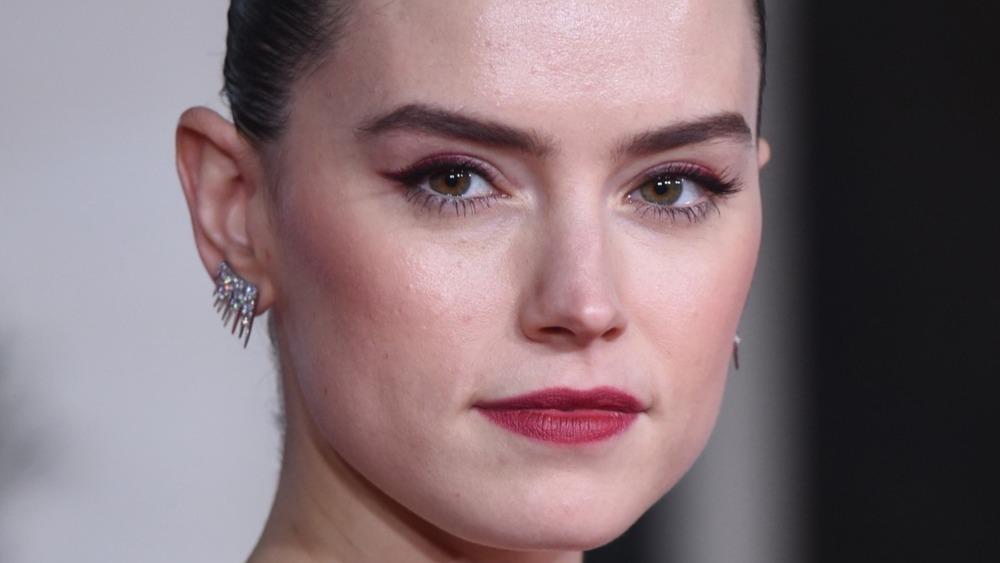 Daisy Ridley wears earrings