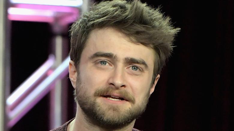 Daniel Radcliffe sitting