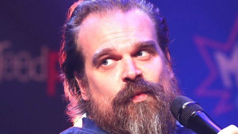 David Harbour speaking into microphone