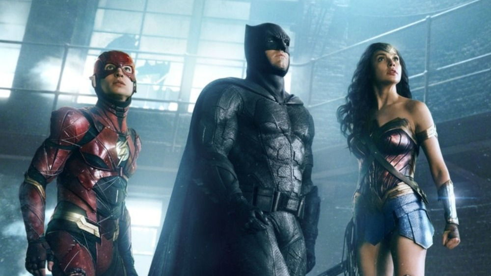 Flash, Batman, and Wonder Woman prepare for looming danger