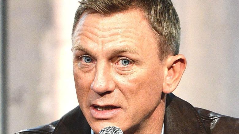 Daniel Craig with a microphone