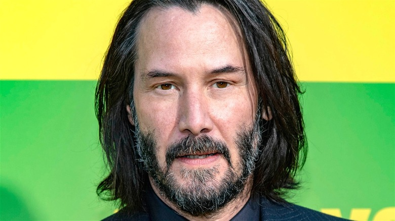 Keanu Reeves long hair beard headshot