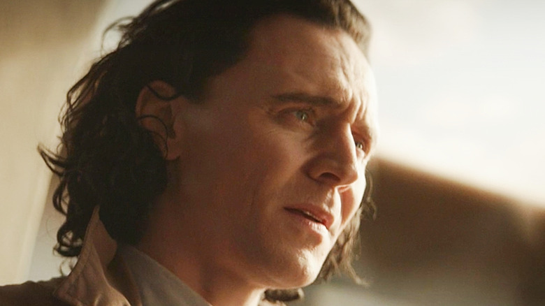 Tom Hiddleston as Loki looking concerned