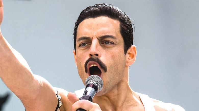 Rami Malek as Freddie Mercury singing