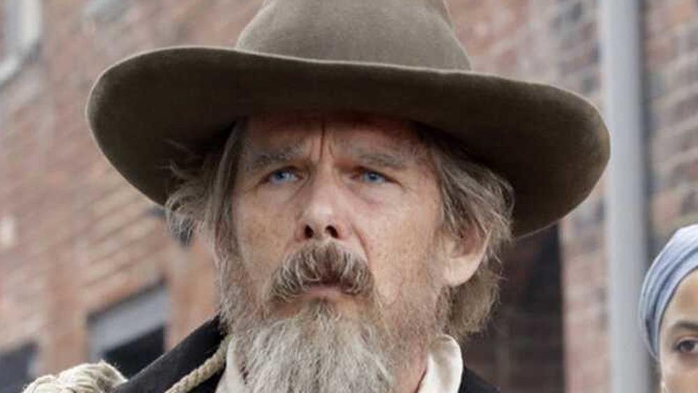 Ethan Hawke as John Brown in brown hat on Good Lord Bird