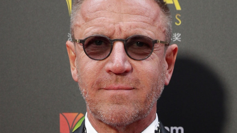 Renny Harlin attends a premiere