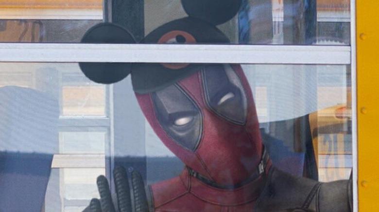 Deadpool wearing Mickey Mouse ears Disney Fox merger