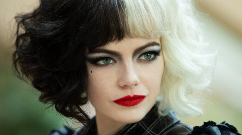 Emma Stone Cruella black and white hair red lipstick