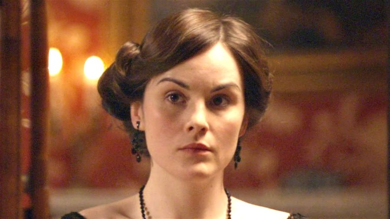 Michelle Dockery as Mary listening on Downton Abbey