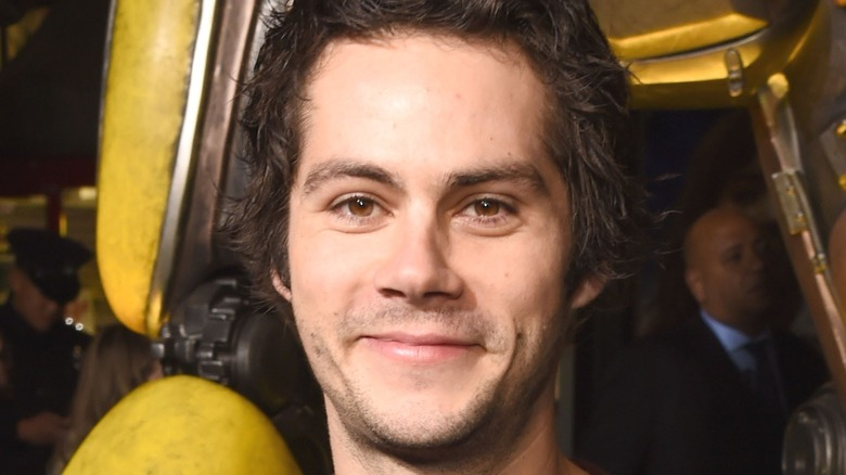 Dylan O'Brien in front of Bumblebee