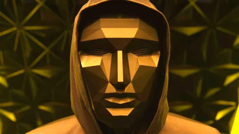 The Front Man wearing mask and hood