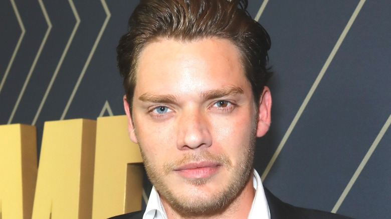 Dominic Sherwood with slicked back hair