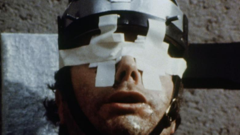Faces of Death bandaged eyes man