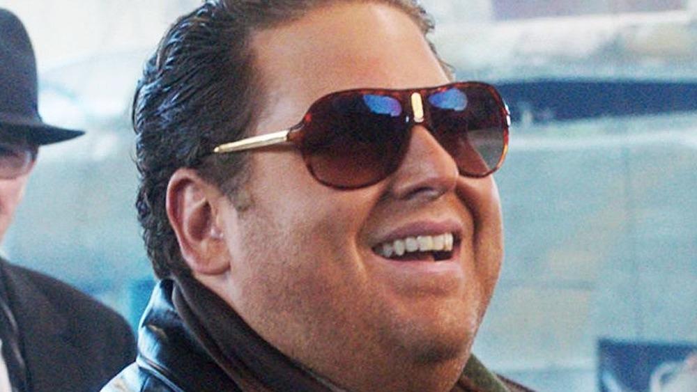 Jonah Hill smiles in sunglasses