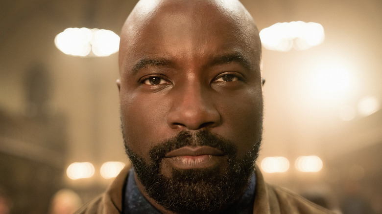Mike Colter staring straight