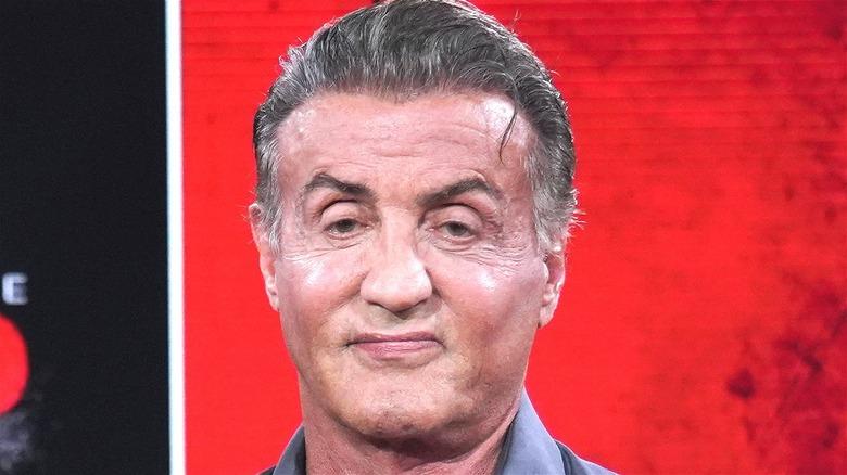 Sylvester Stallone smirking