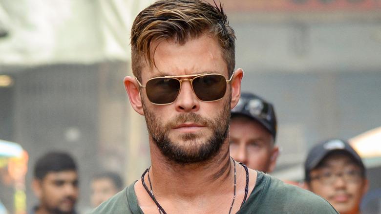 Chris Hemsworth wearing sunglasses in Extraction