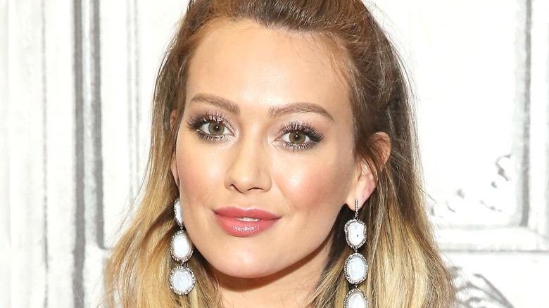 Hilary Duff with white dangling earrings