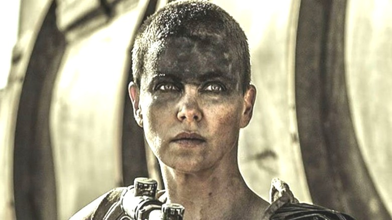 Furiosa standing by her war rig