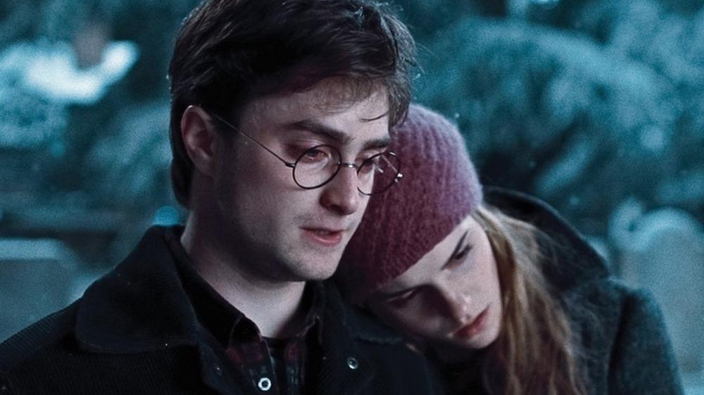 Emma Watson as Hermione and Daniel Radcliffe as Harry