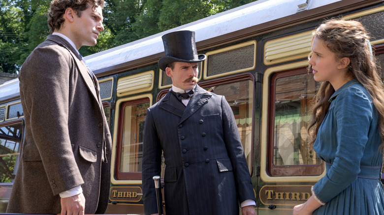 Siblings Sherlock (Henry Cavill), Mycroft (Sam Claflin), and Enola Holmes (Millie Bobby Brown) in Netflix's Enola Holmes