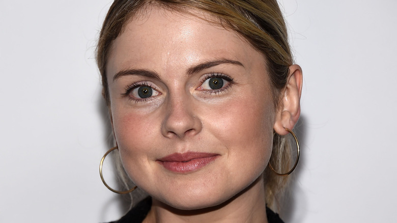 Rose McIver smiling in front of white background