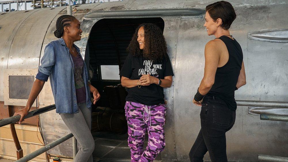 KiKi Layne (Nile), director Gina Prince-Bythewood, and Charlize Theron (Andy) on the set of The Old Guard