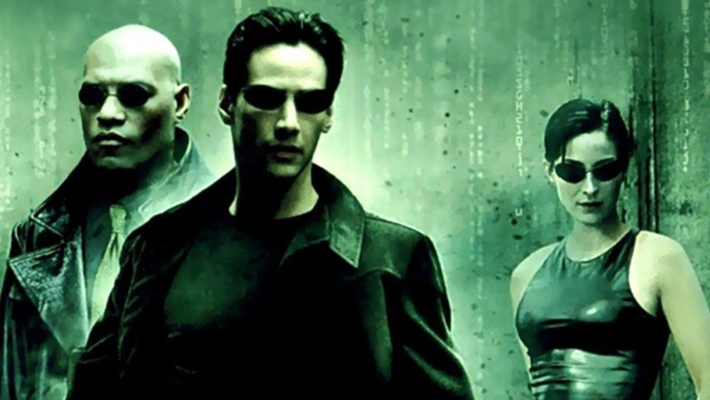 Keanu Reeves as Neo, Carrie-Anne Moss as Trinity, and Laurence Fishburne as Morpheus in The Matrix