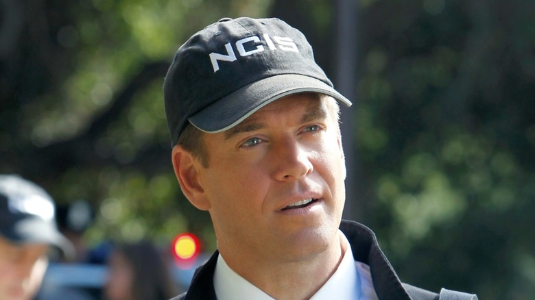 Tony DiNozzo wearing NCIS hat outside